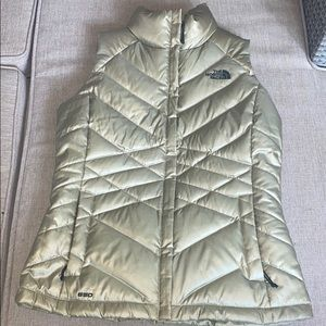 The North Face small 550 down vest metallic  gold